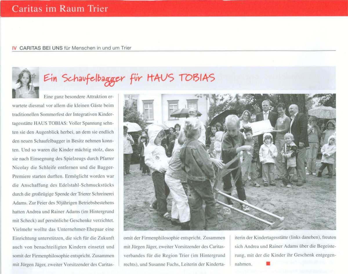 Artikel in der Caritas-Zeitung über die Spendenaktion der Schreinerei Adams zur Anschaffung des Schaufelbaggers für das Haus Tobias
